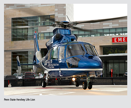 Life Lion helicopter on landing pad in front of Emergency Department at Penn State Hershey Medical Center