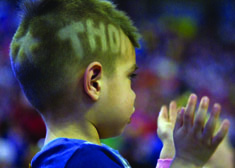 A young boy with THON shaved into his haircut