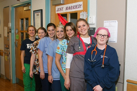 The nurses of 7 West pose for a picture outside the room of patient Courtney Sprenkle.