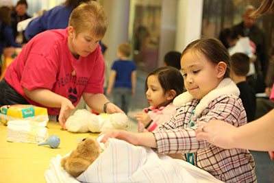 Children learned how to properly swaddle their new teddy bears