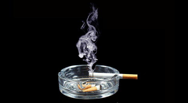Burning cigarette in an ashtray