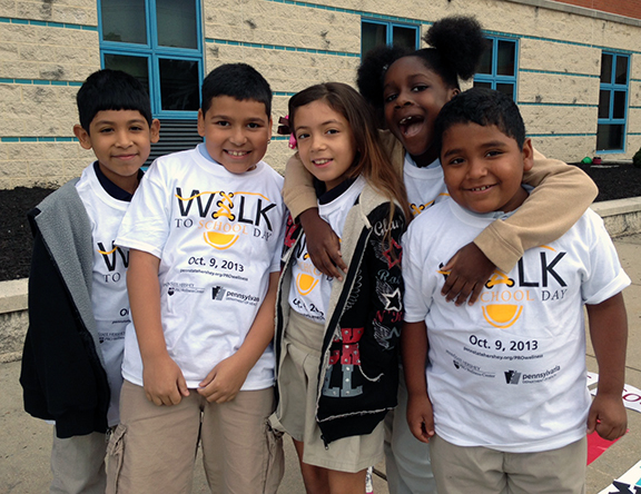 Students at Lincoln Charter School in York, Pa., during a Walk to School day they organized last fall thanks to a Safe Routes to School mini-grant from Department of Health and administered by Penn State Hershey PROWellness Center.