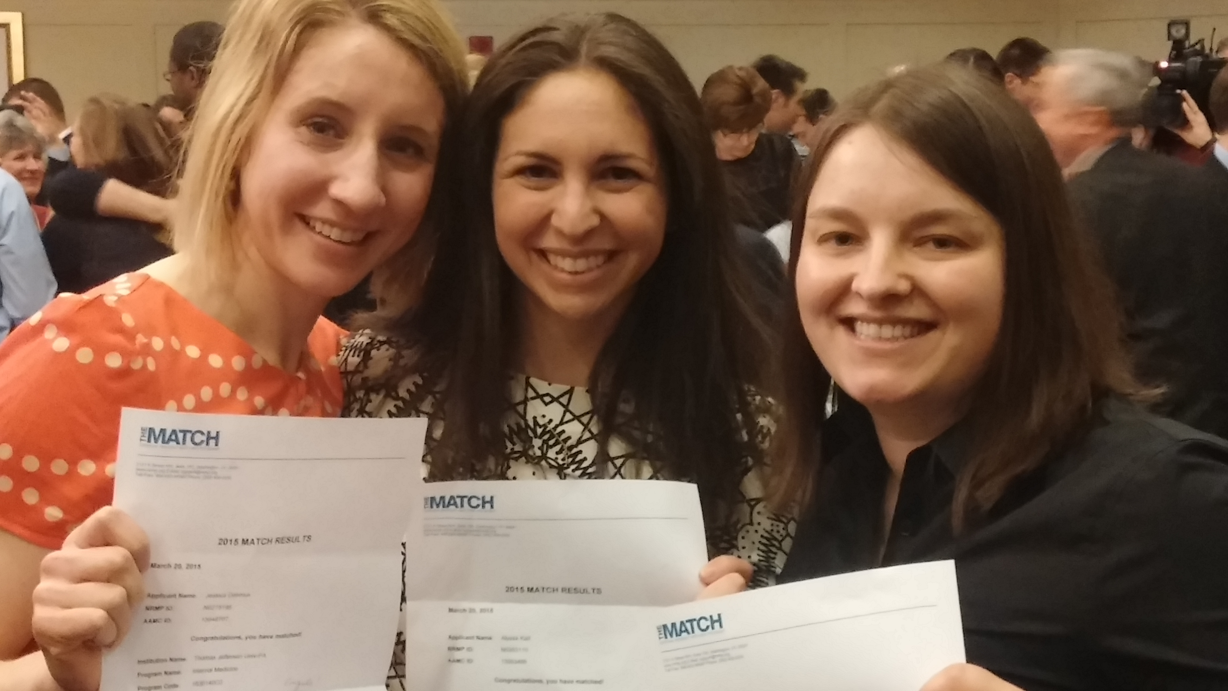 Fourth-year medical students proudly display their match letters.