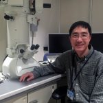 Han Chen, MD, PhD, became director of the Penn State College of Medicine Transmission Electron Microscopy Facility in February 2016. Chen is pictured at right, seated and facing the camera, with the microscopy equipment behind him to his left.