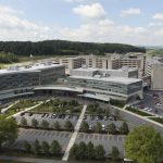 An aerial view of the Milton S. Hershey Medical Center and Penn State College of Medicine campus, with the Children's Hospital, Main Entrance and Cancer Institute in the foreground.