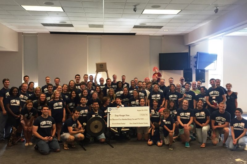 The Physician Assistant Class of 2017 poses with a check respresenting their donation to Stop Hunger Now.