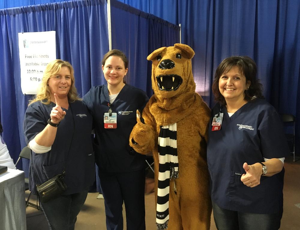 Nurses provide flu shots at the Farm Show - Penn State ...