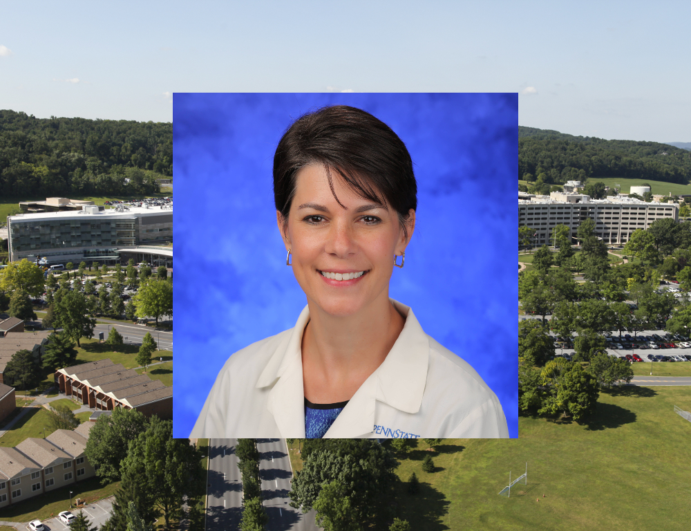 An image of Dr. Margaret Mikula, superimposed over a larger photo of the Hershey Medical Center/College of Medicine campus.