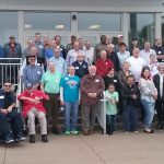 Approximately 40 people - all heart transplant recipients - pose for a photo on the steps of the University Conference Center on the Hershey Medical Center campus.