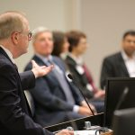 Kevin Harter of Penn State Center for Medical Innovation addresses a panel consisting of Anthony P. Bihl, Andrea Lauber, Jacquelyn Fetrow and Nishit Trivedi at the 2016 Innovation Awards ceremony. The 2017 event will be held Nov. 28. Harter is pictured at left, looking to the right of the photo with his arm outstretched toward the panel, who are pictured facing the camera and Harter.