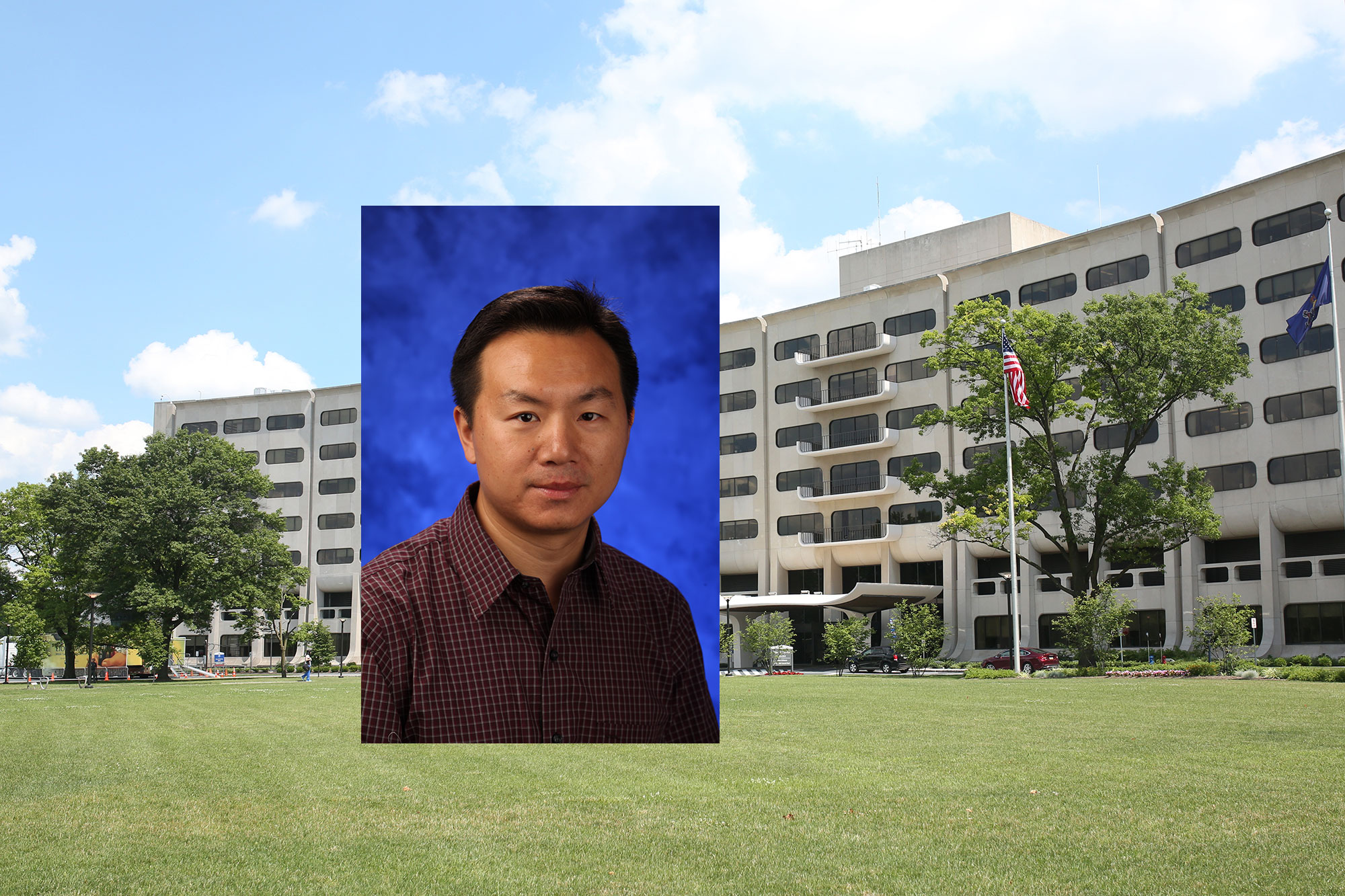 Feng Yue, assistant professor in the Department of Biochemistry and Molecular Biology at Penn State College of Medicine, recently received a $1.91 million Outstanding Investigator Award via the Maximizing Investigators' Research Award mechanism from the National Institutes of Health. A photo of Yue wearing a plaid collared shirt in front of a blue photo background is superimposed to the left of center of a photo of Penn State College of Medicine's Crescent Building at 500 University Drive, Hershey, PA, showing the building curving around the back with a green lawn in front.