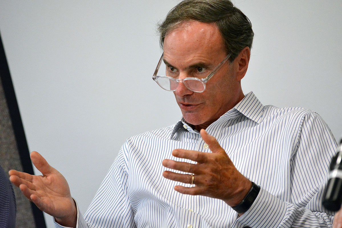 Michael Hund leads the panel discussion at the Innovation Forum held Sept. 12 at Penn State Harrisburg. The event was organized in conjunction with Penn State College of Medicine's Center for Medical Innovation. Hund is pictured wearing a dress shirt and glasses, gesturing with both hands as he speaks.