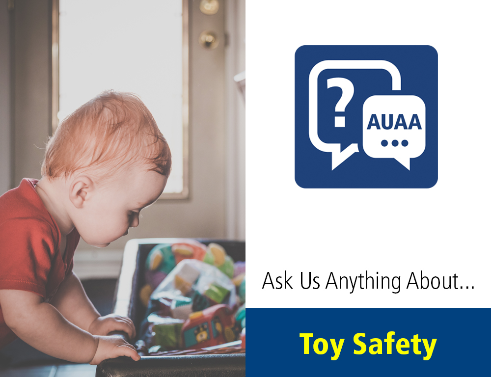 On the left side, a young child leans over a toy chest and peers inside. On the right side is a graphic reading: Ask Us Anything About... Toy Safety