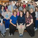 Staff and providers at Penn State Health Medical Group – Oyster Point celebrate being named Lancaster County's No. 1 family practice by Lancaster County Magazine readers. About 30 people sit in chairs and stand, posing in the practice site's lobby.