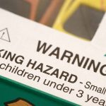 Warning label on toy reads: WARNING: CHOKING HAZARD – Small parts not for children under 3 years with a triangle and an exclamation mark in the middle.