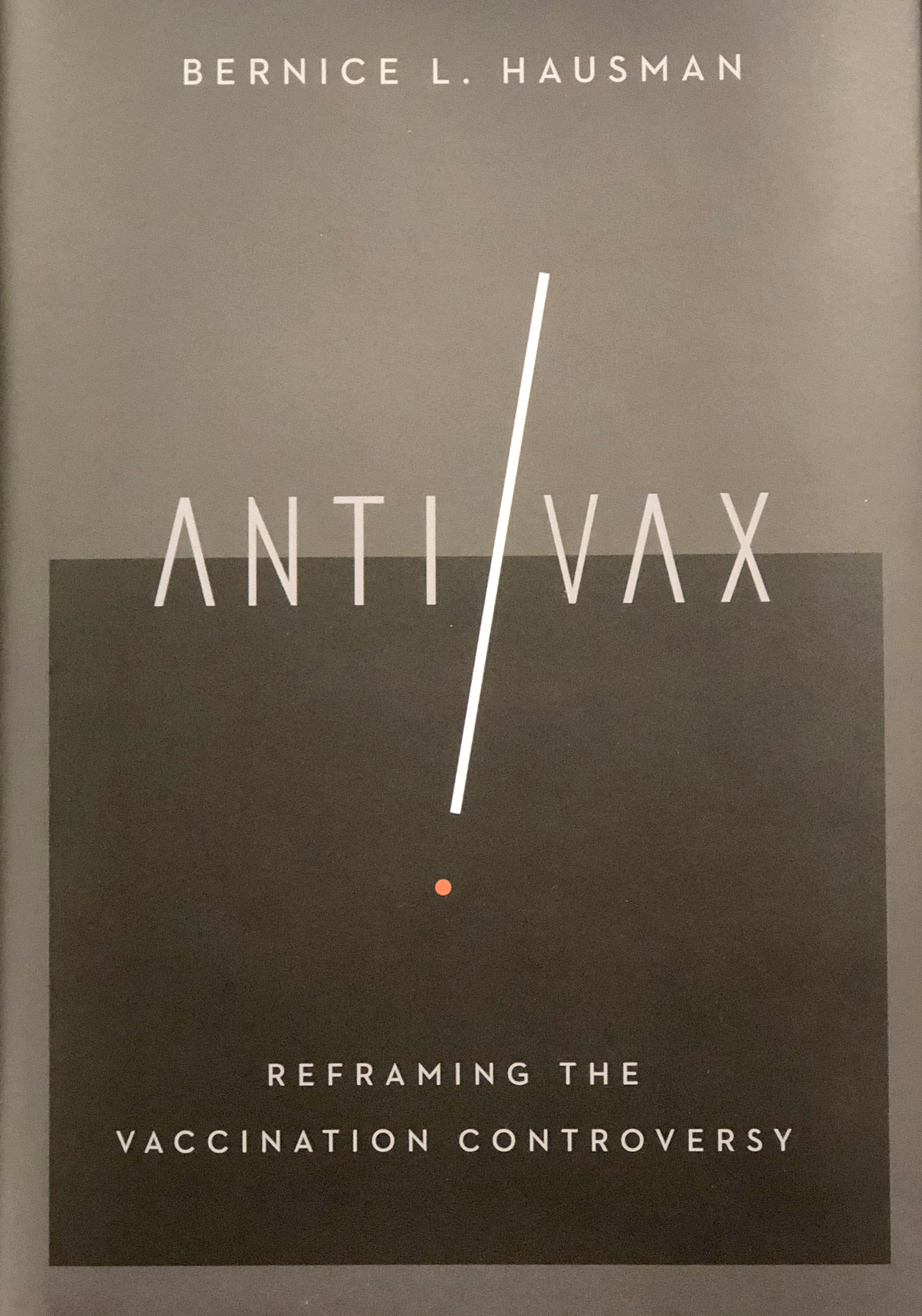 "The cover of Bernice L. Hausman's book, ""Anti/Vax: Reframing the Vaccination Controversy,"" has a graphic of a long slash with a period below it between ""Anti"" and ""Vax."""