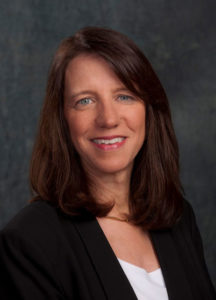 A head-and-shoulders professional photo of Lora Weiss