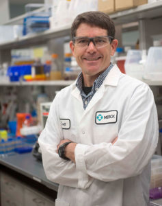 A professional photo of Scott Walker of Merck standing in a lab.
