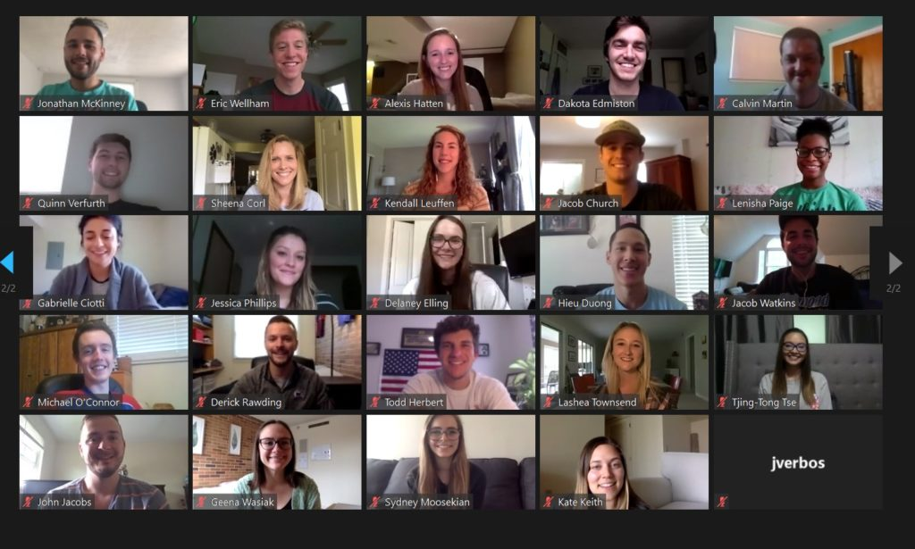 There are 25 rectangles that show people who are participating in a virtual meeting. Each rectangle shows a participant's face on webcam.