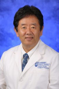 A head and shoulders portrait of Dr. Takehiko Dohi.