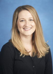 A head-and-shoulders professional photo of Tracy Raulston