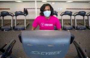 Natasha Burse, a graduate student at Penn State College of Medicine, walks on a treadmill at University Fitness Center.