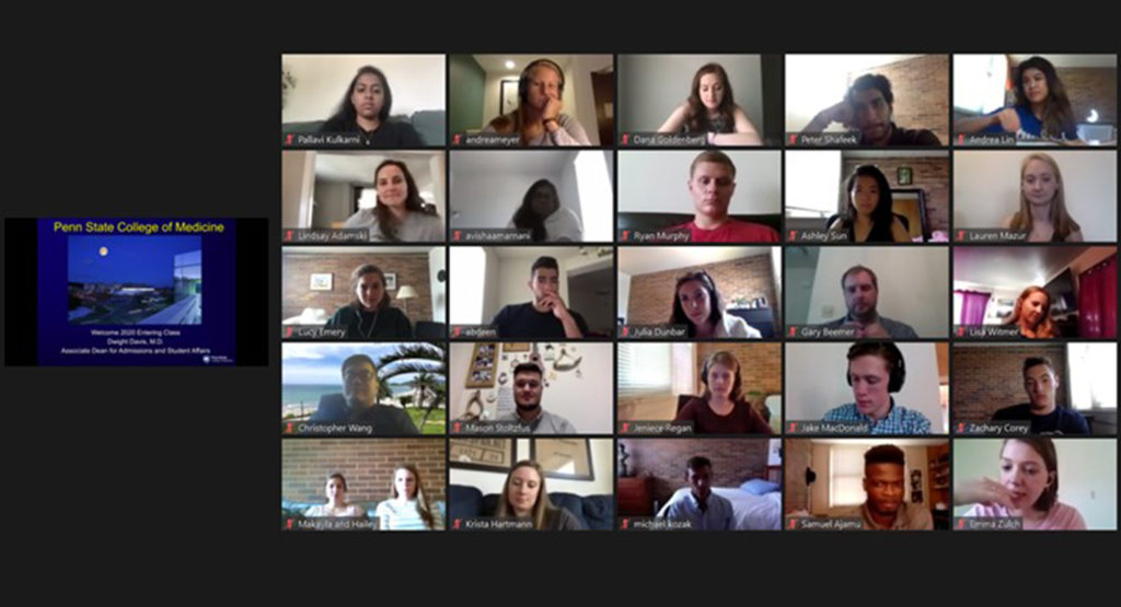 The faces of students participating in a virtual meeting appear on a screen in a grid of five columns and five rows, with a small image of the presenter's screen to the left of the students' faces.