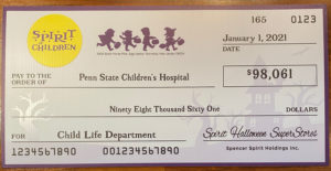 An oversized check from Spirit of Children to Penn State Children's hospital, made in the amount of $98,061.