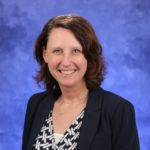 A head and shoulders professional portrait of Susan Veldheer