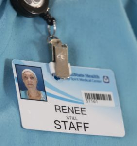 Renee Still's ID badge features her name and a photo of her wearing a head covering.