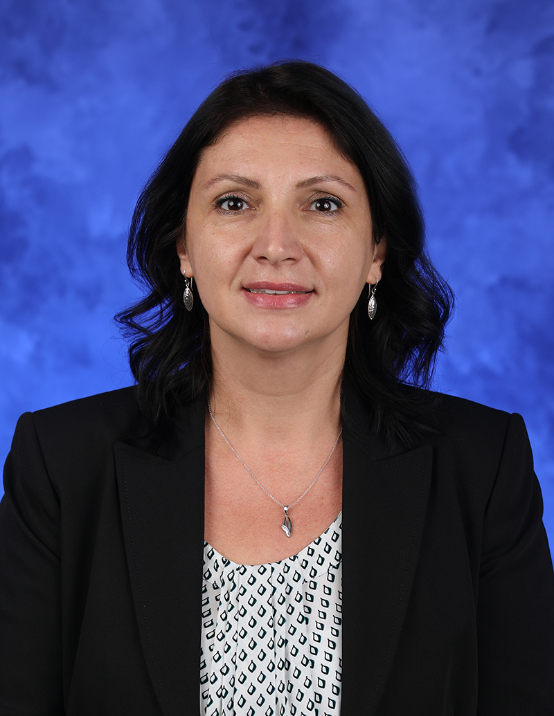 A head-and-shoulders professional photo of Claudia Nicolae, PhD