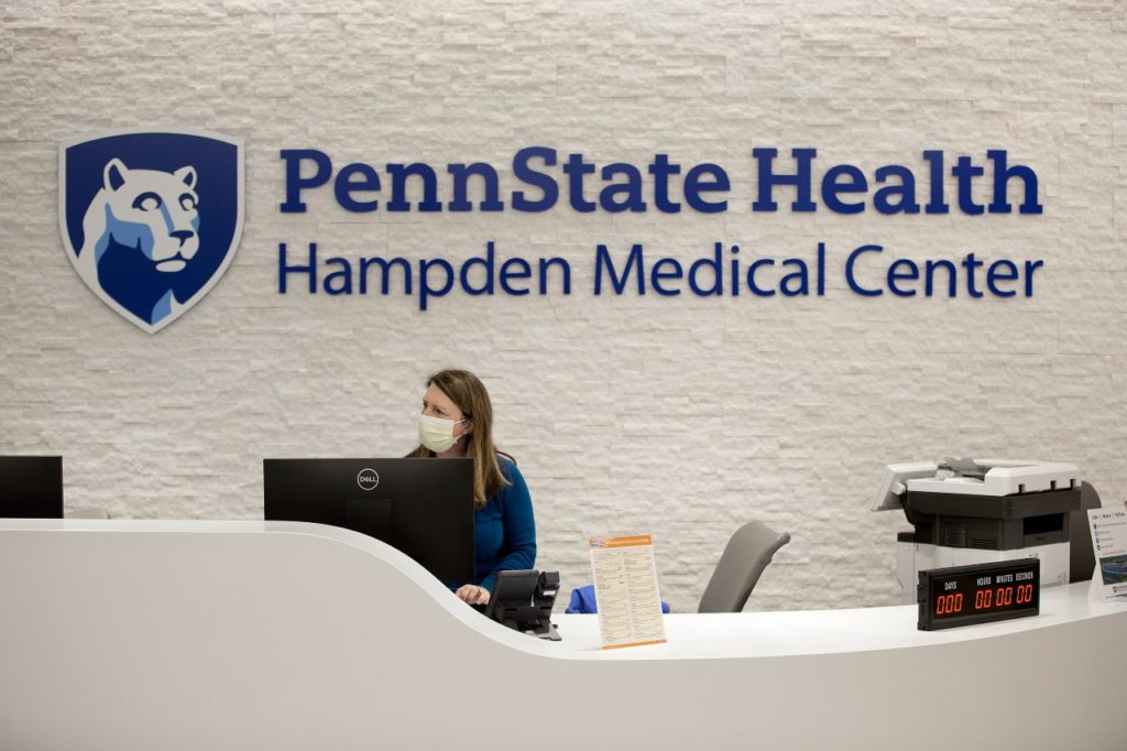 A receptionist starts the first shift at Penn State Health Hampden Medical Center.